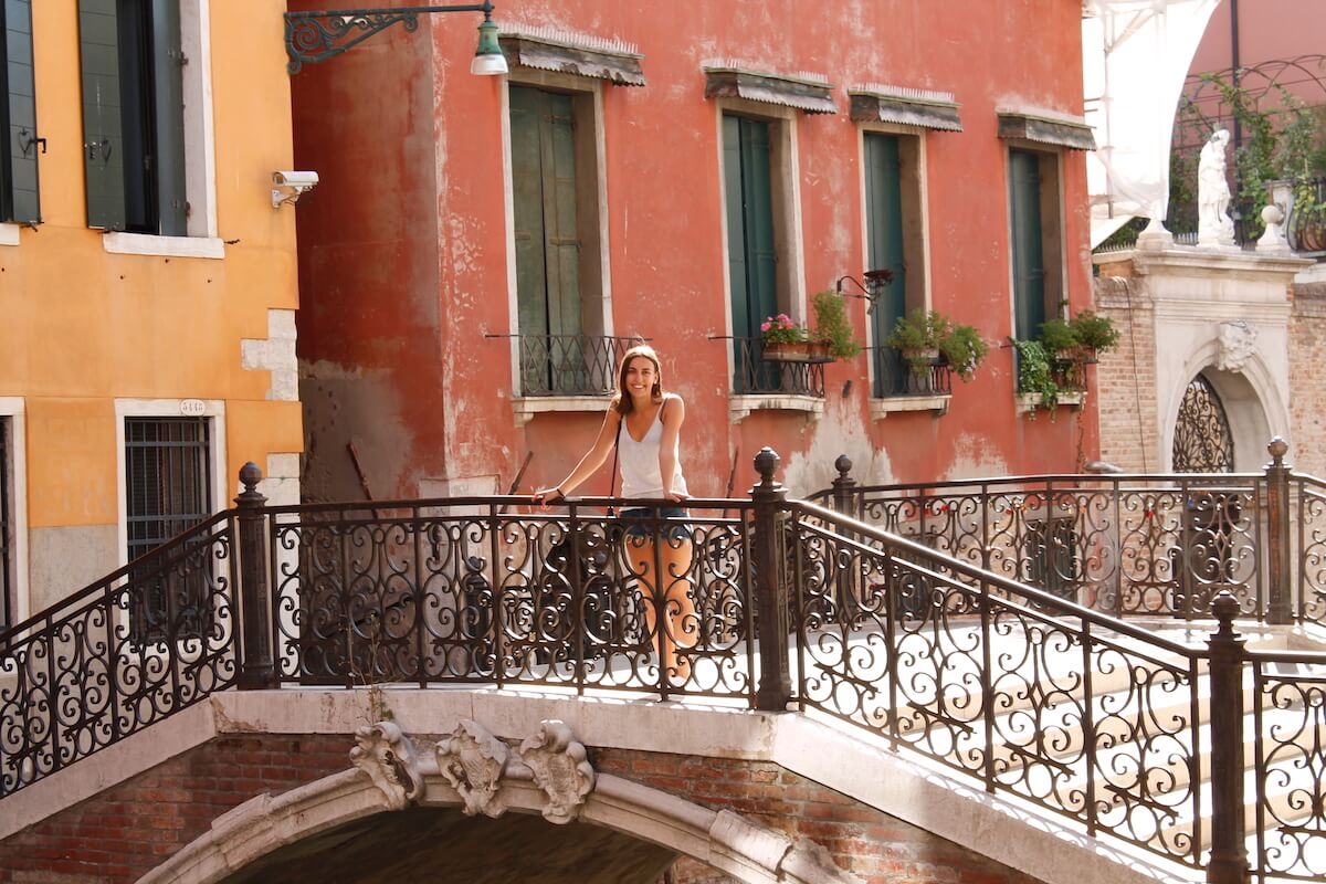I'm8hoursahead on a bridge and canals of Venice