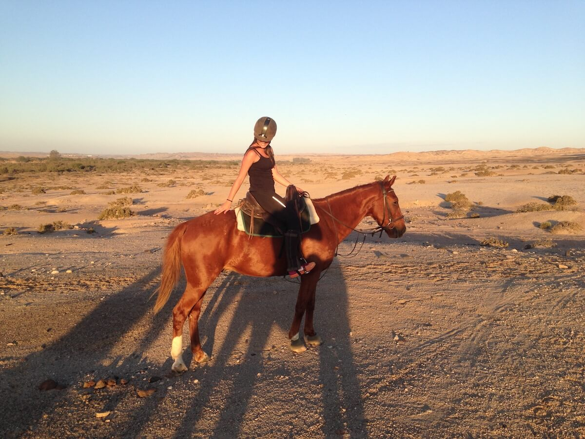 horse riding in the dunes